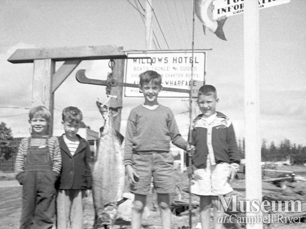 Unidentified children with a salmon at the Willows Hotel