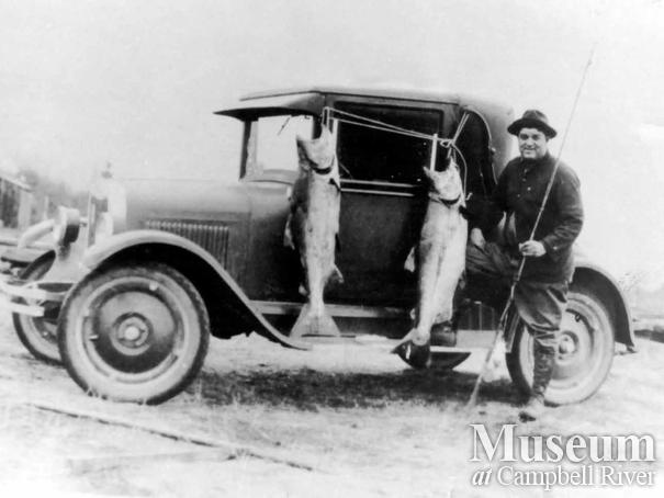 Angler with catch of Tyee salmon