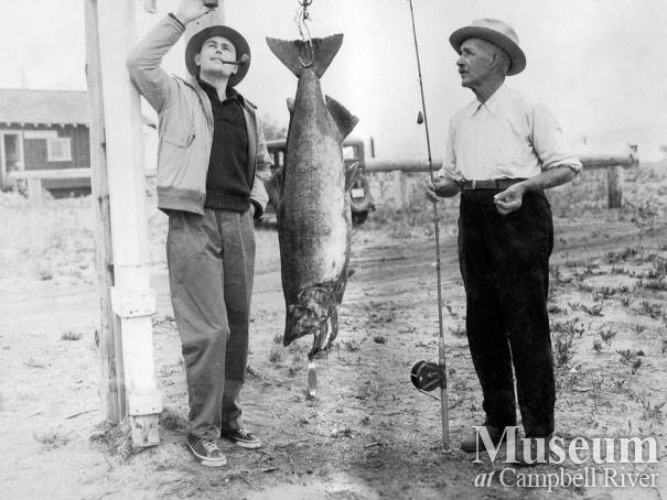 Horace Smith and unidentified man with salmon