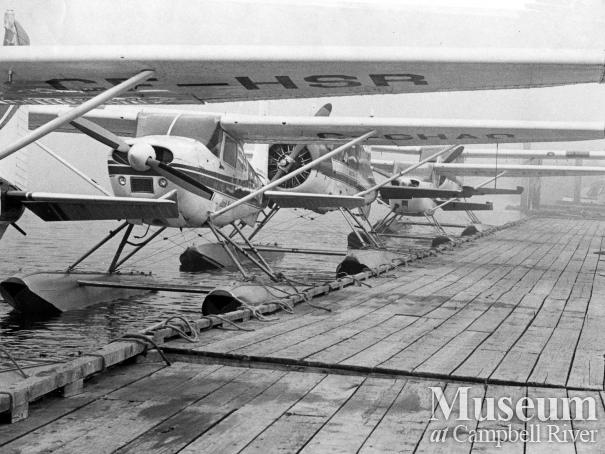 Seaplanes tied up at dock at Tyee Spit, 1976.