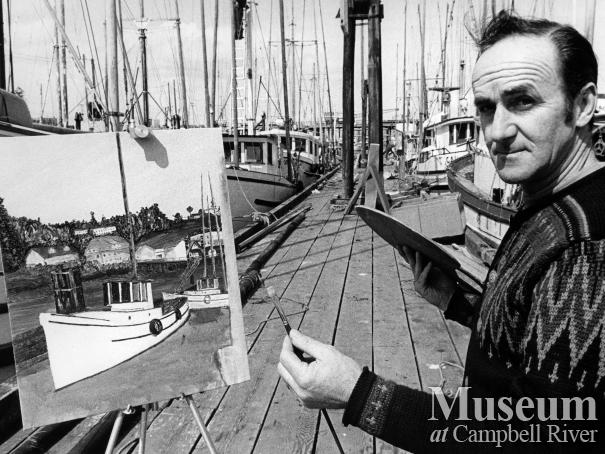 Artist George Borgford painting at the government wharf, Campbell River