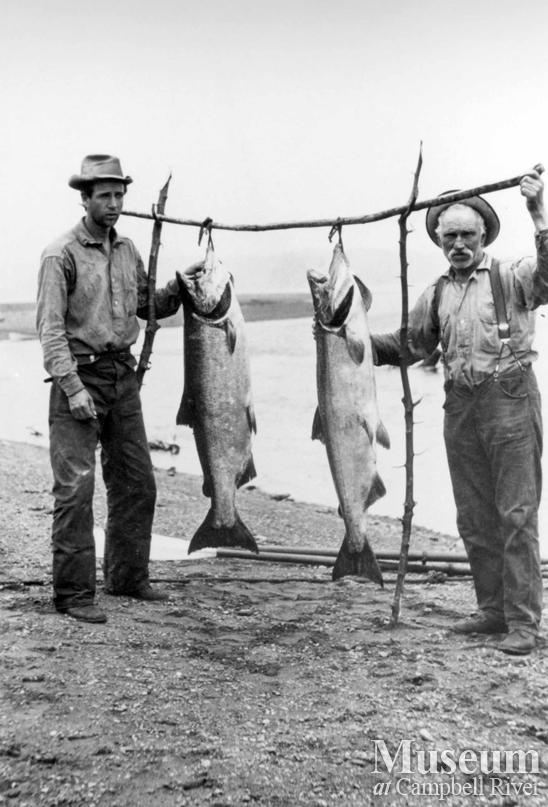 Charlie Hodak with guest and salmon