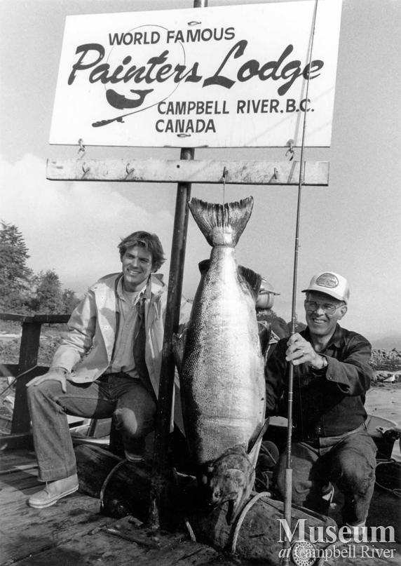 Two unknown anglers with fish