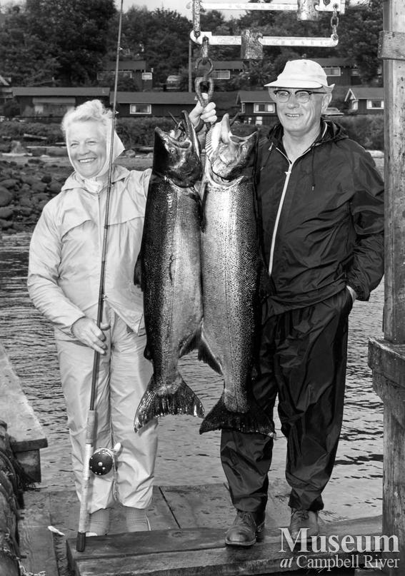 Mrs. Irvin McChesney with her catch of two fish