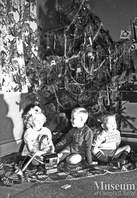 Portrait of Children with Christmas Tree