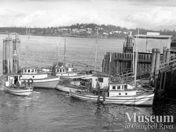 View of commercial fishing boats tied up Campbell River wharf