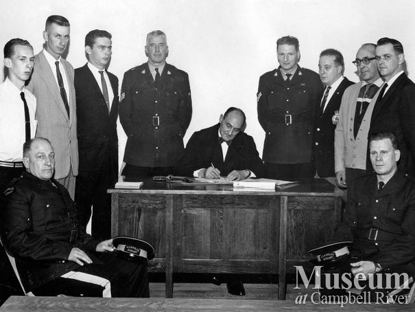 Judge Roderick Haig-Brown with police officers, Campbell River