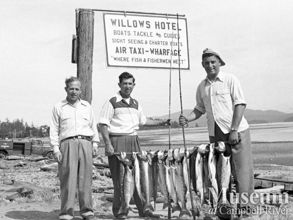 Anglers with their catch on beachfront, Campbell River
