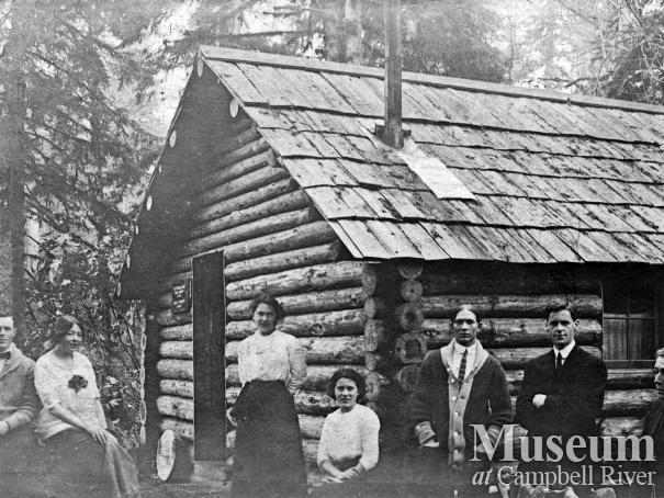 Group at cabin on the banks of the Campbell River
