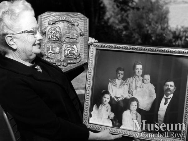 Lillie Thulin with Thulin family portrait, September 1970