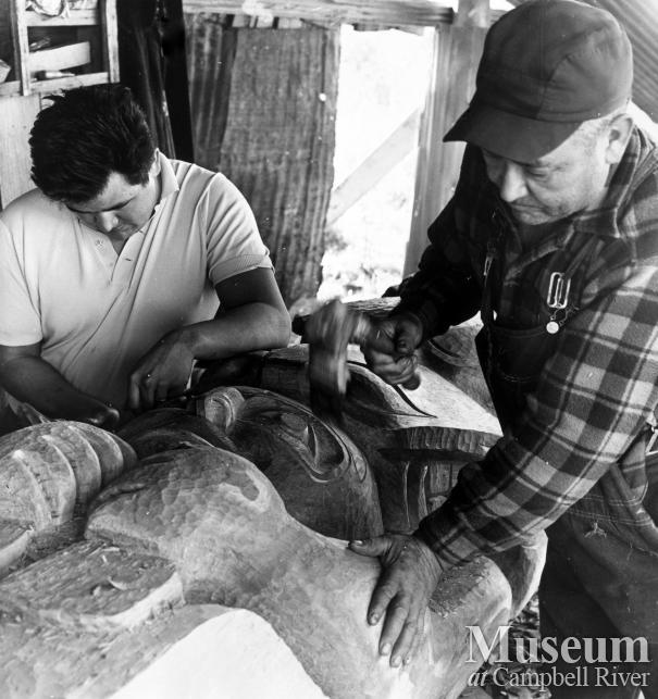 Ernie and Sam Henderson carving the Mileage Totem