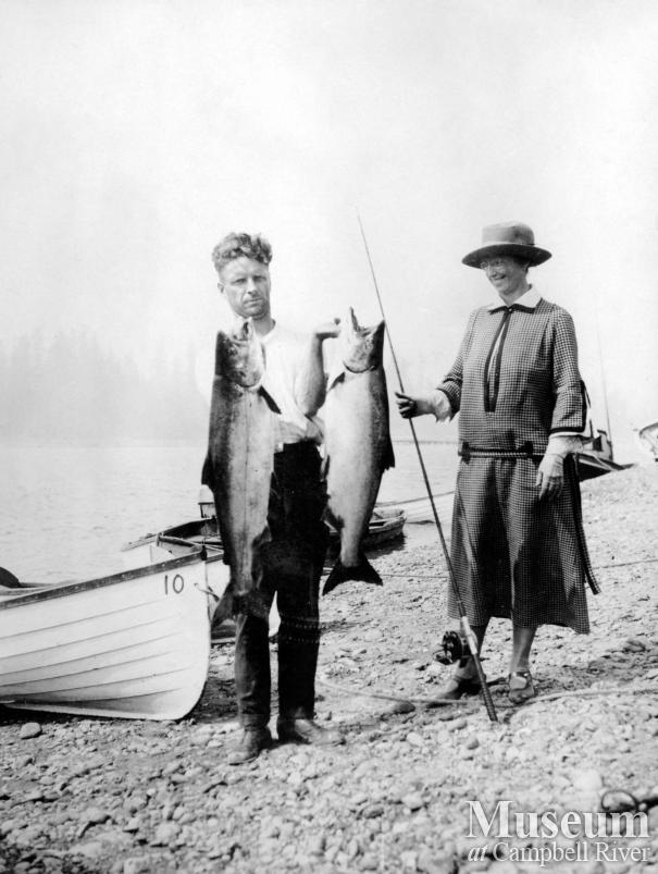 Joe Painter (?) with Mrs. Wiborn and salmon