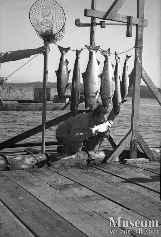 Guest with catch of salmon at Painter's Lodge